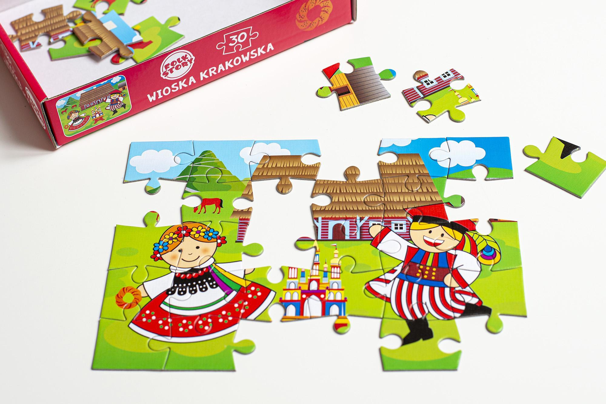 Puzzle  przedstawiające krakowską wioskę i parę ludową w strojach krakowskich